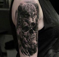 Dog with a skull Tattoo http://tattootodesign.com/dog-with-a-skull-tattoo/