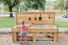 Outdoor Learning: Loving our mud kitchen! So much learning can happen in the outdoors with simple materials!
