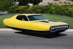Manipulated muscle cars with no wheels.