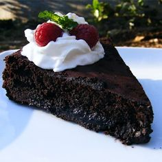 """Warm Flourless Chocolate Cake with Caramel Sauce I """"Dense and rich and SUPER chocolaty -- this is enjoyed by everyone, not just those who are wheat-sensitive."""""""