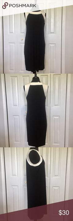 J.Jill black dress with white yoke This dress is new with tags. Fairly straight up and down. Sleeveless. Please measure a similar garment to compare fit. Measurements taken flat. Shoulder to shoulder 14 inches. Armpit to armpit 19 inches. Hem 21 1/4 inches. Back of neck to hem 36 3/4 inches. J. Jill Dresses