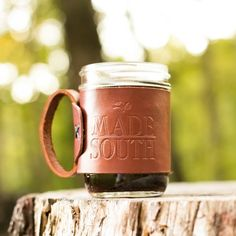 The MADE SOUTH Mug is handmade in Alabama using harness leather, copper rivets and indigo cording. It is perfect for sipping your favorite coffee in the morning and your favorite bourbon in the evening. Comes with one Mason WIDE MOUTH jar and one lid.