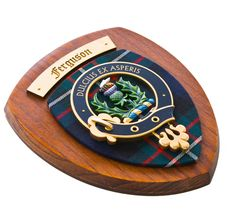 This Scottish dark wood Clan shield features a beautifully detailed hand painted crest and motto which is mounted on a traditional pure new wool tartan, pertaining to your family. Our small Clan wall plaques look stunning in any room of the home or workplace. Heraldic Scottish family crests compliment and enhance your home decoration.