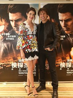 The A-list: Tom Cruise, 54 posed with his co-star Cobie Smulders, 34, at a photocall in Beijing, China for their new flick, Jack Reacher: Never Go Back