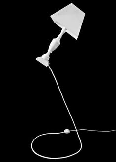The whimsy of this floor lamp makes me laugh