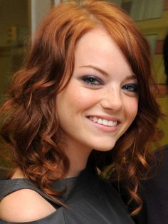Emma Stone...the style and length seem like a good possibility for me.  Long enough to put up on lazy days, short enough to not be dying from hot hair on my neck in the summer.