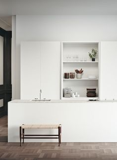 Minimalist white kitchen with parquet floor