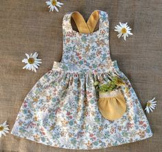 Create your own Tui Pinafore with our beginner friendly sewing pattern, you'll love this pinafore sewing pattern for girls created by Below the Kowhai. The Tui Pinafore is a beautiful vintage style pinafore for girls. Linen Dress Pattern, Pinafore Dress Pattern, Girls Pinafore Dress, Baby Girl Dress Patterns, Dress Sewing Patterns, Baby Patterns, Paper Patterns, Skirt Patterns, Coat Patterns
