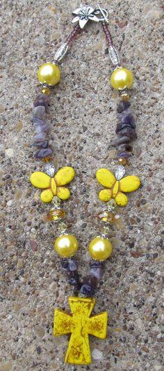 """Yellow Cross & Butterfly 12"""" http://www.shop.donnasjewelryboxdallas.com/"""