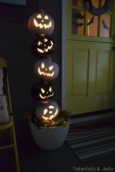 "Black and White Halloween Topiary: For this easy Halloween project, prime five pumpkins, spray paint three white and two black, and drill 1"" holes into each. Click through to find more cheap and easy ideas for DIY Halloween decorations."