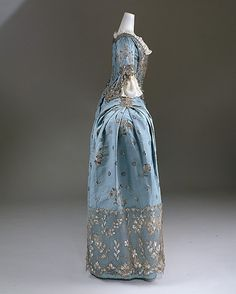 Court gown, British, c1750. Photo: Metropolitan Museum of Art, New York. Behind the eighteenth window of my advent calendar of FLOUNCY DOOM there is this completely ridiculous court dress from the 1750s. What joy. Not really one for making an entrance unless there's a massive doorway involved as otherwise you'd have to sidle in pathetically …