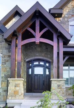 Bold colors on over sized gabled entry  draw attention to this front entry