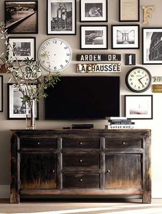 Pottery Barn wall....Great way to decorate around your tv. Surrounding it with images you love would make it more appealing when it's off.