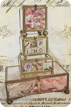 brass and glass display box~via Wendy Burns