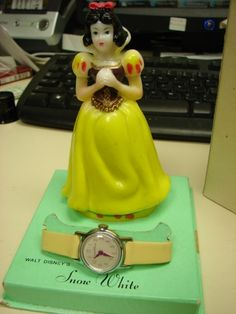 Although my figurine broke a long time ago...I still have my watch.  My very first watch.  A gift for my 1st Holy Communion