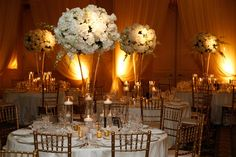 Classic White Centerpieces in Chicago    Photography: KingenSmith   Read More:  http://www.insideweddings.com/weddings/timeless-ivory-gold-wedding-with-scottish-traditions-in-chicago/727/