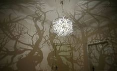 Light 3D Printed Lamp.  Casts eerie gnarly tree branches on the wall.
