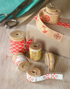 DIY Decorative Tape: To make rolls of pretty tape, round up your favorite patterned wrapping paper, and purchase double-side mounting adhesive. You'll also need a new or vintage spool.