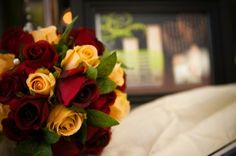 """Red and Yellow Rose bouquet for """"Respectfully Remembered"""" Table."""