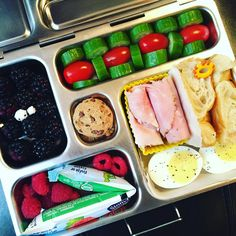 Tuesday's @planetbox lunch is @boarshead_official rosemary ham roll-ups, croissant, boiled egg, @stonyfield yogurt tube, raspberries, blackberries, cucumbers, tomatoes, and #nutfree #peanutfree Skeeter cookies. #peanutallergies #bentobox #bento #eattherainbow #rockthelunchbox  #organic #planetbox #planetboxlunches #healthy #healthykidslunch #healthykidscommunity #realschoolfood #lunchbox #igmeals #planetboxlunches #playwithyourfood #funfood @rockthelunchbox