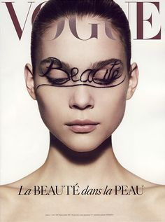 Stephanie Rodriguez. Vogue Paris beauty supplement, October 2007. Kim Noorda by Mark Sega. The typeface for the title is a Serif. The object is a magazine advertisement for a beauty supplement directed towards the beauty/fashion world and consumers. The typography used frames the models head perfectly so that the writing on her face stands out and tells you what it is about. the color of the typefaces makes them blend in with the picture and not cause too much attention to them.
