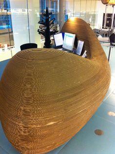 Cardboard desk in library of Amsterdam Cardboard Chair, Cardboard Design, Cardboard Paper, Cardboard Crafts, Cardboard Furniture, Diy Pallet Furniture, Furniture Projects, Reception Desk Design, Stand Design