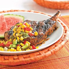 A light and refreshing summer relish spices up perfectly grilled pork chops.