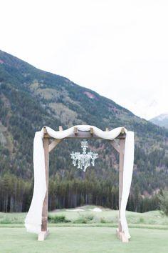 Elegant chuppah with a crystal chandelier: http://www.stylemepretty.com/canada-weddings/2014/12/09/canadian-rocky-mountain-pastel-wedding/ | Photography: Christine Pienaar - http://www.christinepienaarphotography.com/