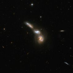 ESO 255-7 : Interacting Galaxies - This interacting quartet of galaxies is around 550 million light-years distant in the constellation Puppis. Although it appears there are only three interacting galaxies, the top component is actually two galaxies. The bottom galaxy is substantially obscured by dust