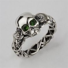 Bespoke Skull & rose wedding ring custom made in solid silver with green tsavorite eyes by leading UK bespoke skull jewellery designer Stephen Einhorn London.