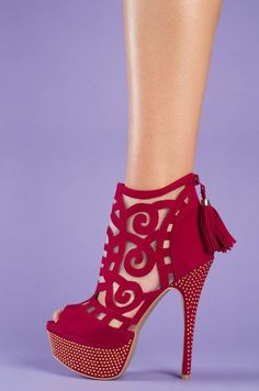 Love the cutout work on these heels, not sure how I would like them on, but I like the picture