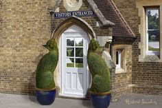 """~ """"The Topiary Cat's Home."""" This is how surrealist artist Richard Saunders imagines the home of The Topiary Cat, welcoming visitors at the Visitor's Entrance. Cat Garden, Dream Garden, Garden Art, Garden Design, Richard Saunders, Topiary Garden, Topiaries, Parcs, Beautiful Gardens"""