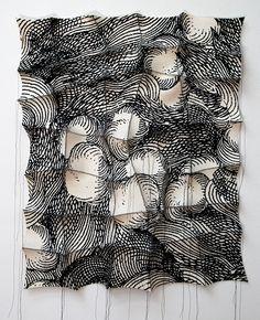 "'singiru'  2012  29"" x 24"" x 2"" industrial felt, digitally engineered image, silkscreen printing, hand stitching"
