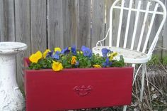 Old drawer painted and used as a flower pot on front porch...adorable.