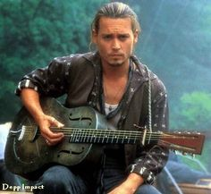 Johnny Depp as a gypsy in Le Chocolat. Love a guy with a guitar and Johnny plays for real on the soundtrack of this movie.