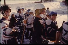 """""""Youngsters at a hockey game at West Side Park below Hermann Heights in New Ulm, Minnesota. Physical fitness is stressed in this community of German descendants. The town has a Turner Club for youth interested in gymnastics. Turnvereins, or Turner Clubs, began in Germany in the 1800s and stress health through exercise, especially gymnastics. The club claims to be one of the co-founders of New Ulm, Minnesota."""" David Rees, January 1975."""