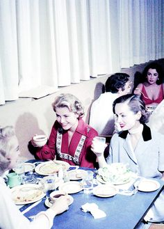 Grace Kelly eating with Ann Blyth and Janet Leigh in the MGM commissary. Elizabeth Taylor is at the table behind her (1954).