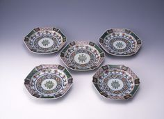 Chinese style dishes with 'longevity' characters. Porcelain with underglaze blue and coloured enamels. Arita ware, mark.