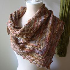 The Cheques Shawlette knitting pattern (this isn't a ready knit shawl - it's a knitting pattern!) - fun, straightforward, perfect for that skein of hand dyed yarn you've been saving.  From Phydeaux Designs.  :)