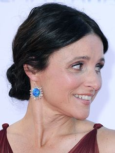Famous Actress Julia Louis-Dreyfus From Old Seinfield Tv Show with her center-part-low-bun hairdo.