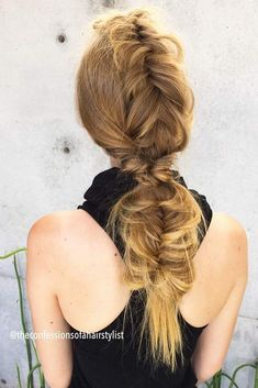 Faux Hawk With A Fishtail Braid #fishtailbraid #longbraid ★ Explore cool, trendy, and easy faux hawk styles for short, medium, and long hair. They can be done on straight and on curly hair. ★ See more: https://glaminati.com/faux-hawk-women-hairstyles/ #fauxhawkhairstyle #fauxhawk #fohawk #glaminati #lifestyle