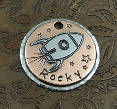 Soaring rocket ID tag for the rocket dog at your house. This custom handmade dog ID tag comes in two sizes, one for a medium dog and one for