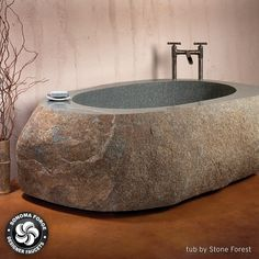 Make the stone age your peg for your next bathroom design project. You'll get a kick out of this Flintstones style bath tub which isn't something that peop Stone Bathtub, Stone Bathroom, Modern Bathroom, Stone Sink, Bathroom Interior, Concrete Bathtub, Deep Bathtub, Natural Bathroom, Stone Bench