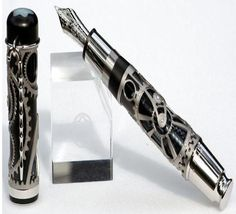 n Montblanc released a limited-edition Charlie Chaplin skeleton pen. It featured gears and a cane for the pen clip. Steampunk Shop, Steampunk Accessoires, Steampunk Architecture, Pen Turning, Fountain Pen Ink, Writing Instruments, Artwork, Gadgets, Fountain Pens