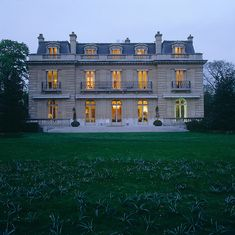 House of Windsor, Paris - The illuminated windows of the 19th century villa glow in the gathering dusk