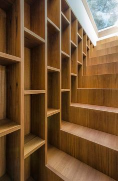 Staircase + Bookcase = Warm Functional Storage Area