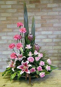 Arrangement with Star Gazer Lilies shaped like stars, pink roses and carnations. Alter Flowers, Home Flowers, Church Flowers, Funeral Flowers, Silk Flowers, Beautiful Flowers, Flowers Garden, Tropical Flower Arrangements, Funeral Flower Arrangements