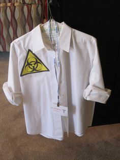 Mad Scientist Costume - my old white shirt for a lab coat, printed biohazard logo, and id badge.  Joseph can wear his regular clothes and just put this over it - very comfy costume.  I will probably also spike his hair real crazy and put some dark shadow under his eyes so he looks like he has been up all night in the lab!