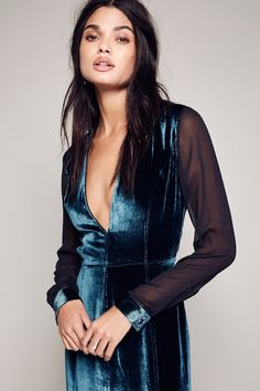 Still searching for a stylish holiday party dress? Look no further than this incredibly cool blue velvet dress. You can turn it into a polished look with a ...