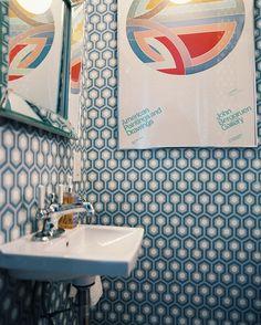 Bathroom - David Hicks's hexagon-patterned wallpaper in a powder room